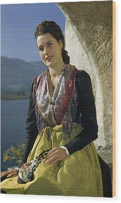 Seated Woman Wears Dirndl Skirt Wood Print by Volkmar Wentzel