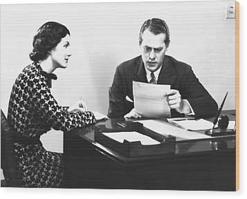 Secretary Assisting Businessman Reading Document At Desk, (b&w) Wood Print by George Marks