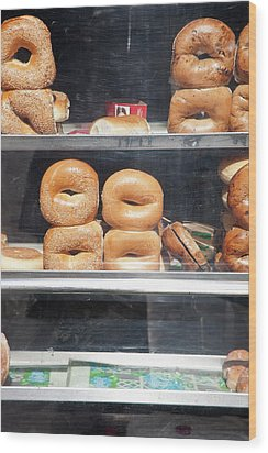 Selection Of Bagels On Shelves Behind A Shop Window Wood Print by Paul Hudson
