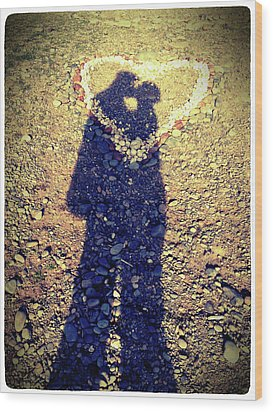 Shadows Of Couple Kissing Over Heart Of Stones Wood Print by Daniel MacDonald / www.dmacphoto.com