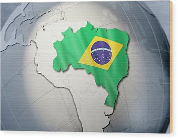 Shape And Ensign Of Brazil On A Globe Wood Print by Dieter Spannknebel