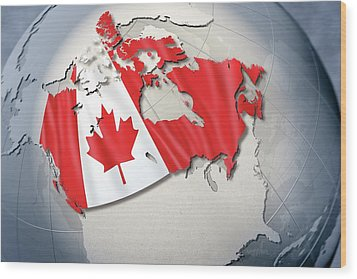Shape And Ensign Of Canada On A Globe Wood Print by Dieter Spannknebel