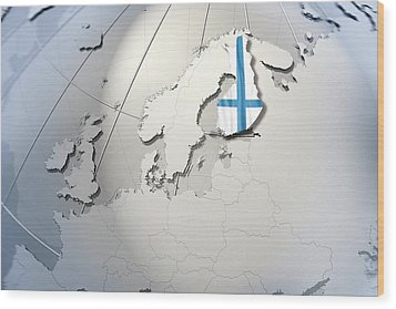 Shape And Ensign Of Finland On A Globe Wood Print by Dieter Spannknebel