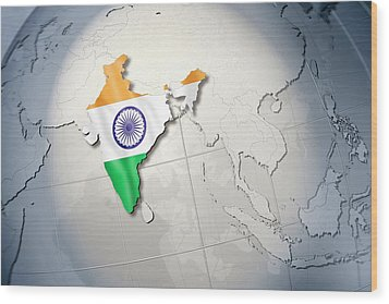Shape And Ensign Of India On A Globe Wood Print by Dieter Spannknebel