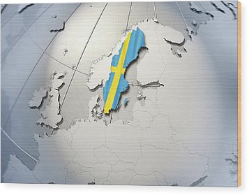 Shape And Ensign Of Sweden On A Globe Wood Print by Dieter Spannknebel