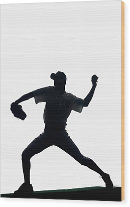 Silhouette Of Baseball Pitcher About To Pitch Wood Print by PM Images