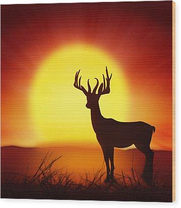 Silhouette Of Deer With Big Sun Wood Print by Setsiri Silapasuwanchai