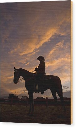 Silhouetted Cowboy Actor On Horseback Wood Print by Ralph Lee Hopkins