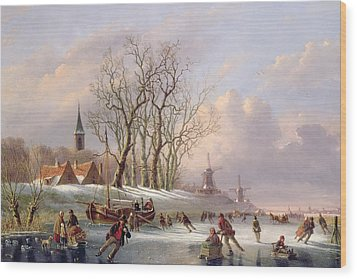 Skaters On A Frozen River Before Windmills Wood Print by Dutch School