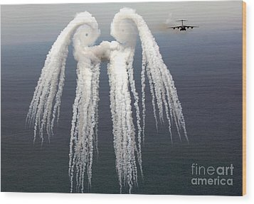 Smoke Angel Created By Wingtip Vortices Wood Print by Photo Researchers