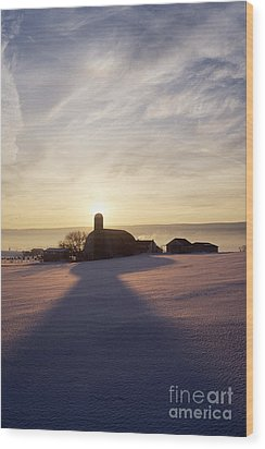 Snow Covered Field With Farm Silhouette At Sunset Wood Print by Jeremy Woodhouse