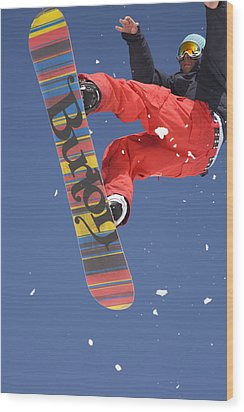 Snowboard Jumping On Vogel Mountain Wood Print by Ian Middleton