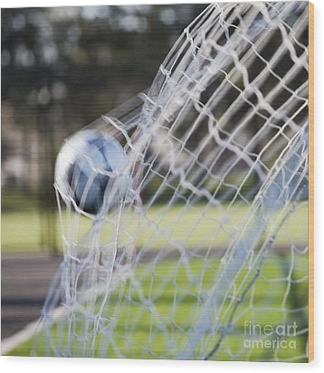 Soccer Ball In Goal Netting Wood Print by Jetta Productions, Inc