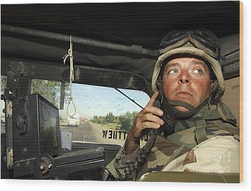 Soldier Monitors The Progress Of A 67 Wood Print by Stocktrek Images