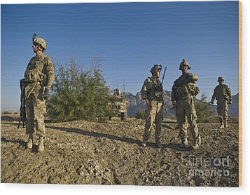 Soldiers Discuss A Strategic Plan Wood Print by Stocktrek Images