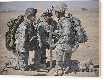 Soldiers Discuss A Strategic Plane Wood Print by Stocktrek Images