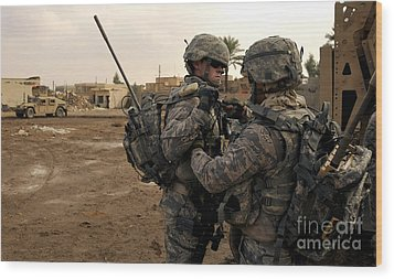 Soldiers Help One Another Wood Print by Stocktrek Images