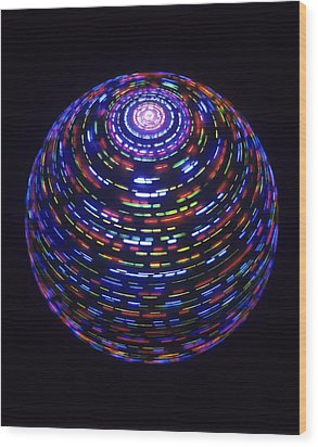 Spinning Globe Wood Print by Lawrence Lawry