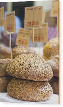 Stacks Of Fresh Bread For Sale Wood Print by Hybrid Images