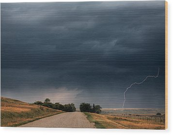 Storm Clouds And Lightning Along A Saskatchewan Country Road Wood Print by Mark Duffy