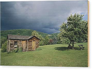 Storm Clouds Form Above A Log Cabin Wood Print by Raymond Gehman