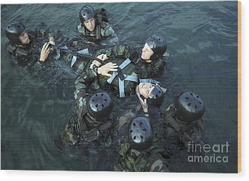 Students Secure A Simulated Casualty Wood Print by Stocktrek Images