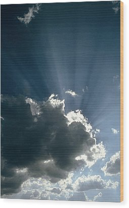 Sun Rays Shining From Behind A Cloud Wood Print by Tony Craddock