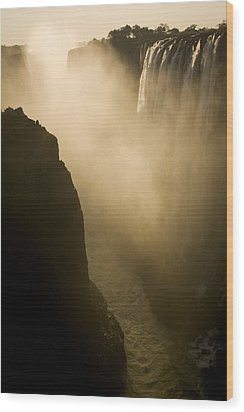 Sunlight Illuminates Mist Rising Wood Print by Ralph Lee Hopkins