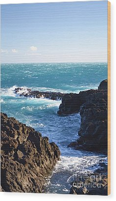 Sunny Day And Stormy Sea Wood Print