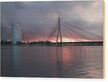 Sunset In Riga Wood Print by Claudia Fernandes