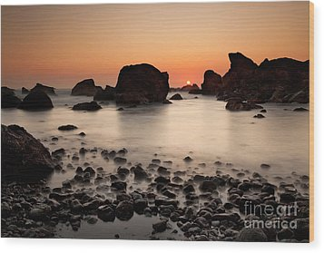 Sunset On A Rock Wood Print by Keith Kapple