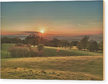 Sunset Over Countryside Wood Print by Verity E. Milligan