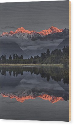 Sunset Reflection Of Lake Matheson Wood Print by Colin Monteath