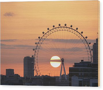 Sunset Viewed Through The London Eye Wood Print by Photograph by Lars Plougmann