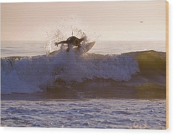 Surfer At Dusk Riding A Wave At Rincon Wood Print by Rich Reid