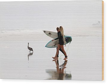 Wood Print featuring the photograph Surfers And A Pelican by Alice Gipson