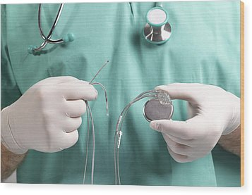Surgeon Holding Heart Pacemaker Wood Print by Peter Dazeley