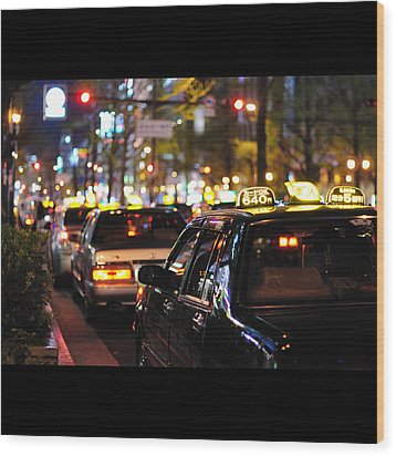 Taxis On Street At Night Wood Print by Thank you for choosing my work.