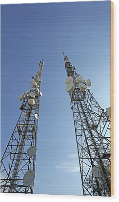 Telecommunications Masts Wood Print by Carlos Dominguez