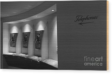 Wood Print featuring the photograph Telephones On Wall by Nina Prommer