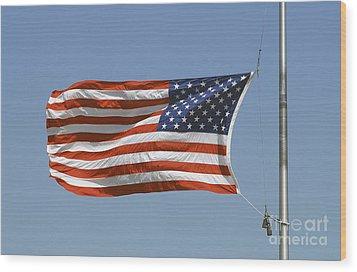 The American Flag Waves At Half-mast Wood Print by Stocktrek Images