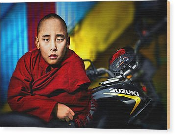 The Boy Monk In Red Robe Standing Beside A Motorcycle In A Buddh Wood Print by Max Drukpa