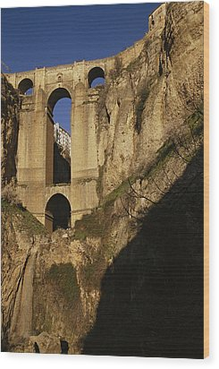 The Bridge At Ronda Spain Connects Wood Print by Stephen Alvarez