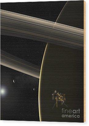 The Cassini Spacecraft In Orbit Wood Print by Steven Hobbs