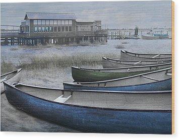The Green Canoe Wood Print by Debra and Dave Vanderlaan