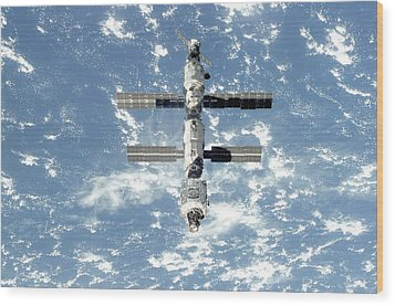 The International Space Station Is Seen Wood Print by Everett
