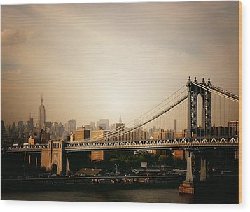 The New York City Skyline And Manhattan Bridge At Sunset Wood Print by Vivienne Gucwa