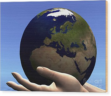 The Planet Earth Is Held In Caring Wood Print by Corey Ford