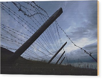 The Remains Of A Barbed Wire Fence That Wood Print by Steve Raymer