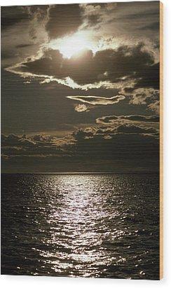 The Setting Sun Pierces A Menacing Wood Print by Jason Edwards